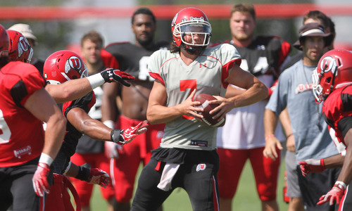 Lennie Mahler  |  The Salt Lake Tribune Utah quarterback Travis Wilson scrambles to avoid defense in a practice scrimmage Saturday, Aug. 11, 2012.