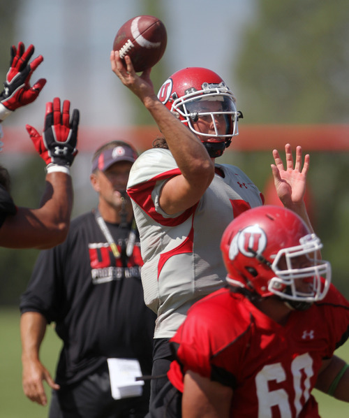 Lennie Mahler  |  The Salt Lake Tribune Utah quarterback Travis Wilson launches a pass in a practice scrimmage Saturday, Aug. 11, 2012.