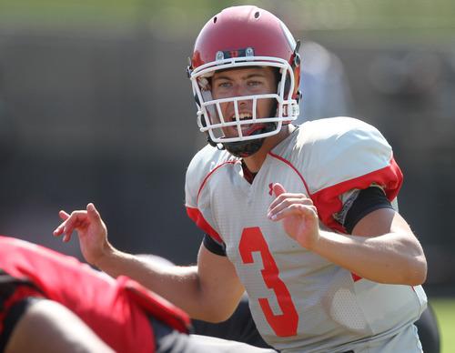 Lennie Mahler  |  The Salt Lake Tribune Utah quarterback Jordan Wynn calls a play during a practice scrimmage Saturday, Aug. 11, 2012.