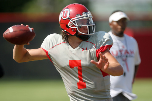 Lennie Mahler  |  The Salt Lake Tribune Utah quarterback Travis Wilson looks for a receiver in a practice scrimmage Saturday, Aug. 11, 2012.