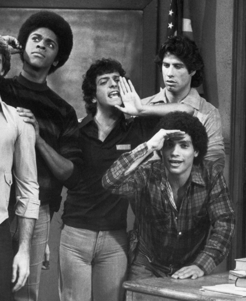 FILE - This 1978 file photo originally from ABC shows cast members, from left, Lawrence Hilton-Jacobs as Freddy Washington, Ron Palillo as Arnold Horshack, Robert Hegyes as Juan Epstein, foreground, John Travolta, rear, as Vinnie Barbarino from the television sitcom