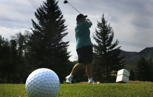 Scott Sommerdorf     The Salt Lake Tribune              Larry Lucero tees off while playing golf at Mountain Dell Golf Course, Monday, August 13, 2012.