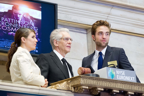 Robert Pattinson and David Cronenberg ring the Opening Bell at NYSE to promote his upcoming film