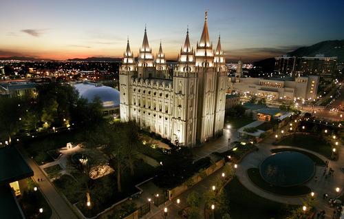 FILE - This April 27, 2006 file photo shows the sun setting behind the Mormon Temple, the centerpiece of Temple Square, in Salt Lake City. (AP Photo/Douglas C. Pizac, File)