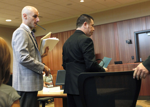 Al Hartmann  |  The Salt Lake Tribune   Roberto Roman, right, enters Fourth District Court in Spanish Fork on Monday, Aug. 13 for jury selection for his murder trial.  His defense lawyer Jeremy Delicino is at left.   Roman is accused of killing Millard County Deputy Josie Greathouse Fox.
