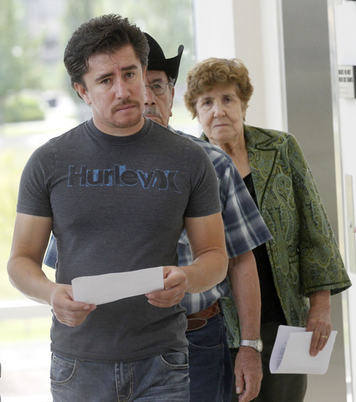 Al Hartmann  |  The Salt Lake Tribune   Mike, left, Jacinto and Juliana Roman, (brother, father and mother) of Roberto Roman enter Fourth District Court in  Spanish Fork on Monday, Aug. 13 for jury selection for his murder trial.   He is accused of killing Millard County Deputy Josie Greathouse Fox.