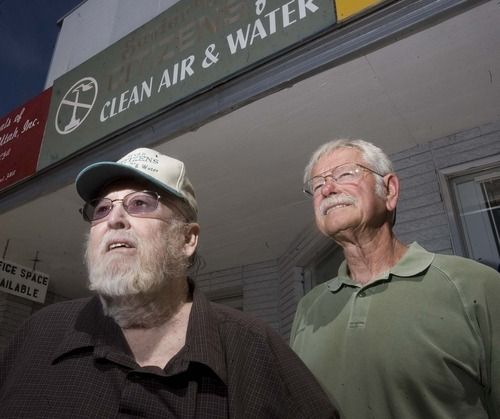 Tribune file photo Dick Cumiskey, right, is pressing local officials to demand an air quality study before the state approves a proposed gas-fired power plant in Sevier County near the town of Sigurd. Cumiskey is shown in the 2009 photo with anti-pollution activist Jim Kennon outside the office they used to wage a years-long battle against the previously planned coal-fired plant. Kennon is deceased.