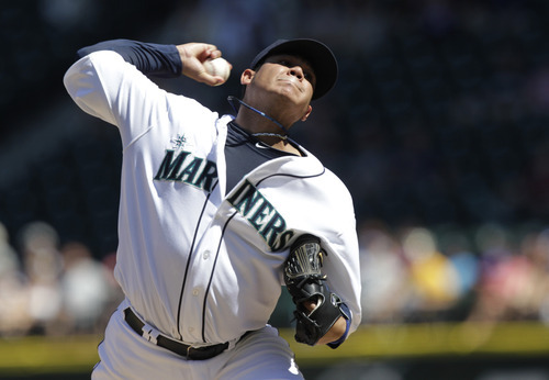 Seattle Mariners starting pitcher Felix Hernandez throws against the Tampa Bay Rays in the fifth inning of a baseball game on Wednesday, Aug. 15, 2012, in Seattle. (AP Photo/Ted S. Warren)