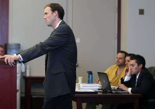 Al Hartmann  |  The Salt Lake Tribune   Prosecutor Thaddeus May questions witness during the second day of a preliminary hearing for Greg Peterson in Third District Court in Salt Lake City Wednesday August 15.