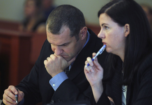 Al Hartmann  |  The Salt Lake Tribune   Prosecutors Joseph Hill and Alicia Cook listen to witness testimony during the second day of a preliminary hearing for Greg Peterson in Third District Court in Salt Lake City Wednesday August 15.