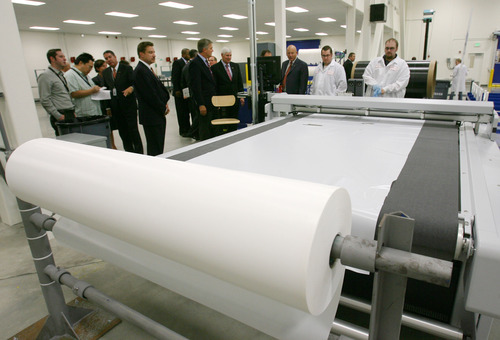 Steve Griffin | The Salt Lake Tribune   Visitors get a guided tour at Exelis, a manufacturing company that makes composite materials for airframes for commercial and military aircraft, during opening of their new composite design and manufacturing center at 5995 west Amelia Earhart Drive in Salt Lake City, Utah Thursday August 16, 2012.