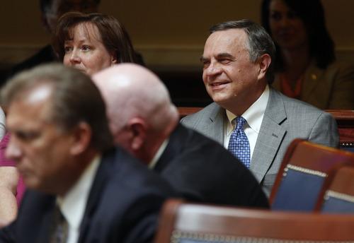 Al Hartmann     The Salt Lake Tribune   Dave Buhler listens on the sidelines of the Utah Senate floor as members voted to confirm him as Utah's new Commissioner of Higher Education.