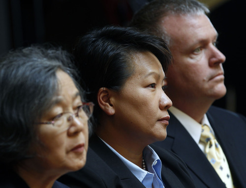 Al Hartmann  |  The Salt Lake Tribune   Judicial nominee Su Chon, center, with mother, left and husband, right, watch as members of the Utah Senate vote to confirm her for a seat on the Third District Court bench on Tuesday August 15.    A Senate subcommittee on Monday declined to endorse Chon for a seat.
