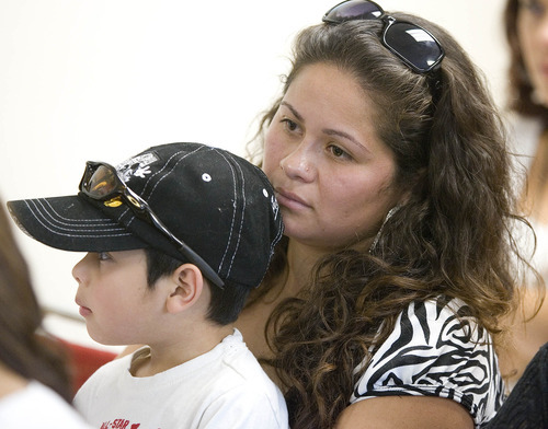 Paul Fraughton | Salt Lake Tribune Esbeyde Rea and her son, Alan,age 5, listen to speakers at a meeting laying out details of President Obama's deferred action program.  Speakers at the meeting  held at the Salt Lake Dream Team Office, announced the launch of workshops that will help people who want to apply for the program.  Wednesday, August 15, 2012