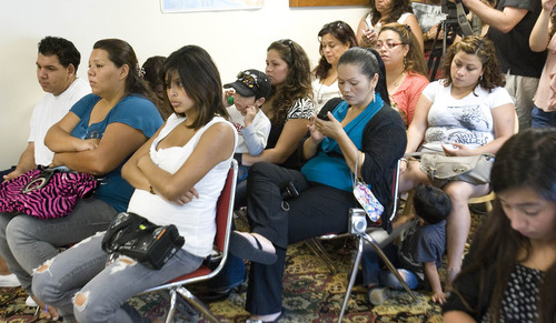 Paul Fraughton | Salt Lake Tribune A packed room of  people, some peeking through open windows listen to speakers at a meeting laying out details of President Obama's deferred action program. Speakers at the meeting  held at the Salt Lake Dream Team Office, announced the launch of workshops that will help people who want to apply for the program.  Wednesday, August 15, 2012