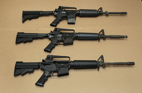 In this photo taken Wednesday, Aug. 15, 2012,  three variations of the AR-15 assault rifle are displayed at the California Department of Justice in Sacramento, Calif.   While the guns look similar, the bottom version is illegal in California because of it's quick reload capabilities.  State Sen. Leland Yee, D-San Francisco, is proposing to change California law to make it more difficult and time-consuming to reload.  The proposed measure is one of a number of gun control laws being introduced in some the nations most populous states after the recent shootings in Colorado.(AP Photo/Rich Pedroncelli)