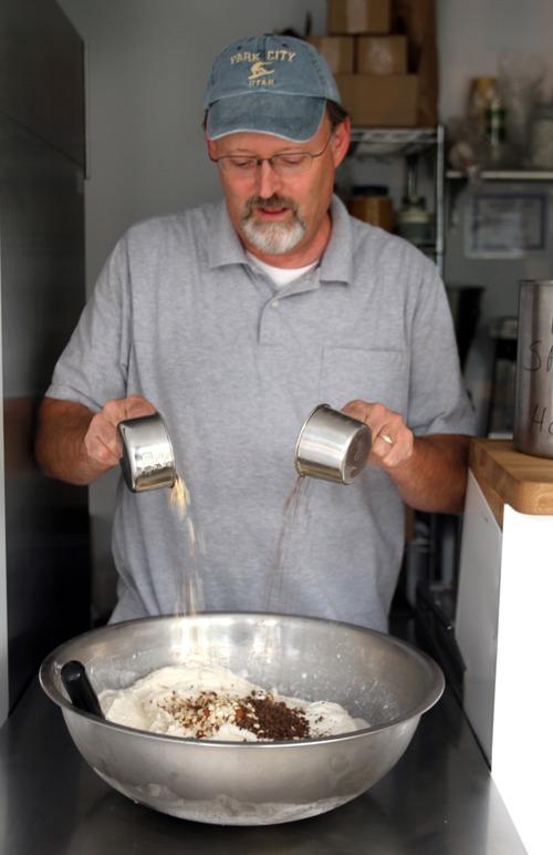 Rick Egan  | The Salt Lake Tribune   Shawn Stuart mixes nuts and chocolate chips into a batch of ice cream at Ice Cream ConeUcopia, 26 E. 600 South, Salt Lake City.