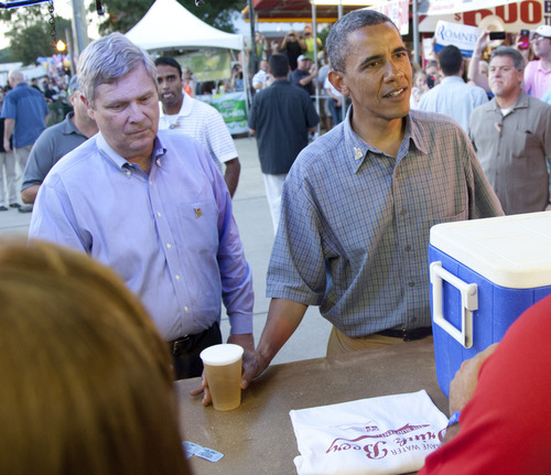 Carolyn Kaster  |  The Associated Press President Barack Obama and  Agriculture Secretary Tom Vilsack visit the beer stand at the Iowa State Fair, Monday, Aug. 13, 2012, in Des Moines during a three-day campaign bus tour through Iowa.