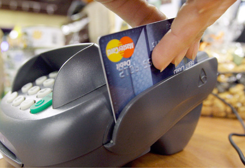 File  |  The Associated Press Businesses with less than $250,000 in revenue a year will have the choice to forgo the standard rate of 2.75 percent per credit-card swipe under the Square plan and instead pay $275 a month with no fees.