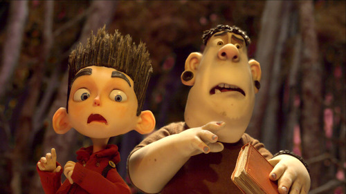 This film image released by Focus Features shows the character Norman, voiced by Kodi Smit-McPhee, left, and Alvin, voiced by Christopher Mintz-Plasse, in the 3D stop-motion film,