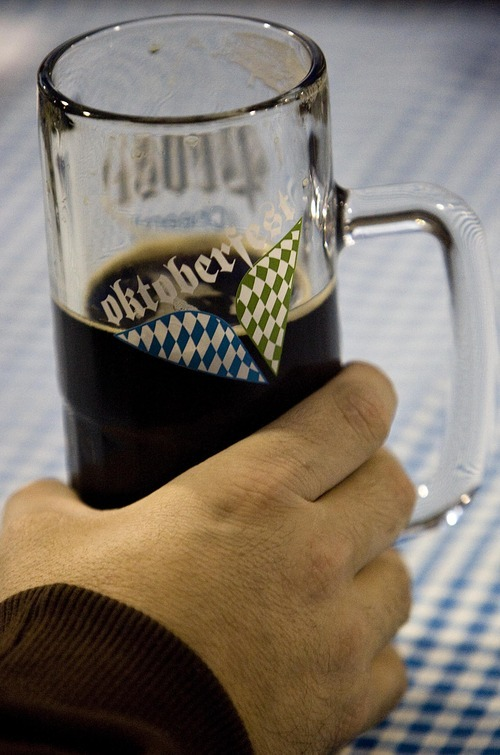 Djamila Grossman  |  The Salt Lake Tribune  A  person holds a beer at the annual Oktoberfest at Snowbird ski resort in Utah, on Sunday, Oct. 9, 2011.