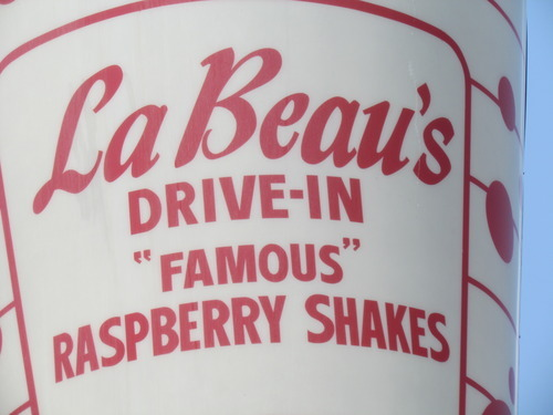 A closeup of LeBeau's Drive-In sign with its claim to