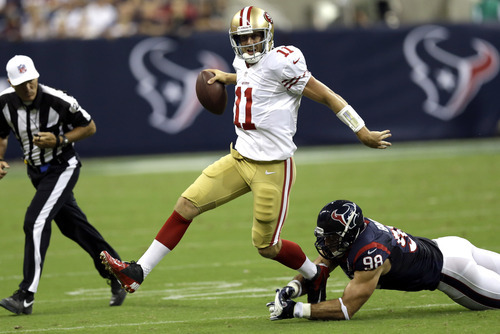 San Francisco 49ers quarterback Alex Smith (11) eludes Houston Texans outside linebacker Connor Barwin (98)  in the second quarter an NFL preseason football game Saturday, Aug. 18, 2012, in Houston. (AP Photo/David J. Phillip)