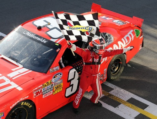 Justin Allgaier celebrates after winning the NASCAR Nationwide auto race Saturday, Aug. 18, 2012 at the Circuit Gilles Villeneuve in Montreal. (AP Photo/The Canadian Press, Tom Boland)