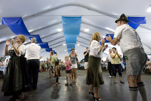 Kim Raff | The Salt Lake Tribune People dance as Salzburger Echo performs traditional music during Snowbird's 40th annual Oktoberfest Celebration at Snowbird Ski Resort  on August 18, 2012.
