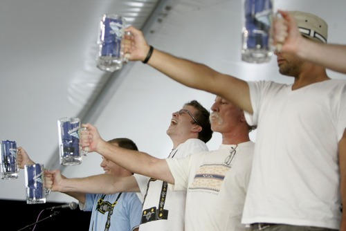 Kim Raff | The Salt Lake Tribune (middle) Morgan Smith struggles to hold up his beer stein during a stein holding contest during Snowbird's 40th annual Oktoberfest Celebration at Snowbird Ski Resort  on August 18, 2012.