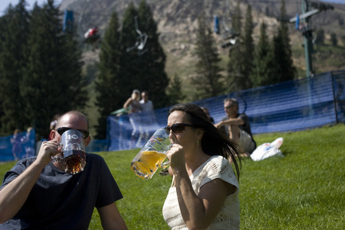 Kim Raff | The Salt Lake Tribune (left) Nick Watson and Jaime Prince drink beer on a grassy hill during Snowbird's 40th annual Oktoberfest Celebration at Snowbird Ski Resort  on August 18, 2012.