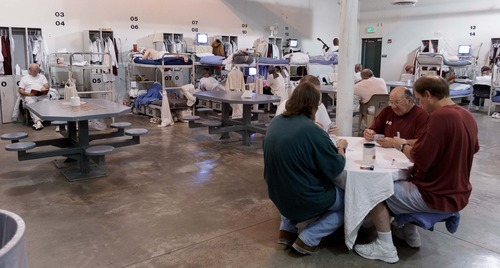 Trent Nelson  |  The Salt Lake Tribune Inmates in a dorm for older inmates at the Utah State Prison in Draper, Utah Wednesday, August 8, 2012.