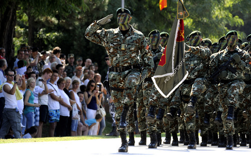 Macedonian Army soldiers, members of the special force battalion Rangers, march during a parade in honor of the 20th anniversary of the Macedonian Army, in the capital Skopje, Saturday, Aug. 2012. (AP Photo/Boris Grdanoski)