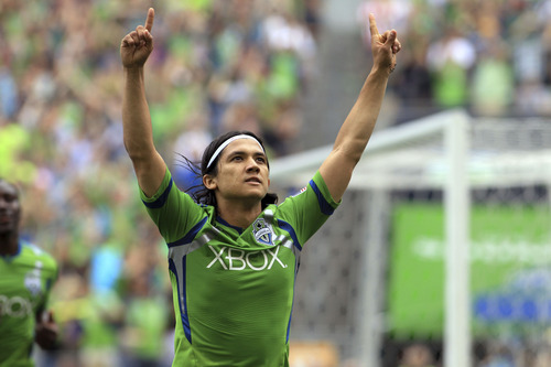 Seattle Sounders' Fredy Montero celebrates his goal scored in the 64th minute against the Vancouver Whitecaps during an MLS soccer game in Seattle, Saturday, Aug. 18, 2012. Seattle won 2-0. (AP Photo/The Seattle Times, Dean Rutz)  SEATTLE POST-INTELLIGENCER OUT; NO SALES; MAGAZINES OUT