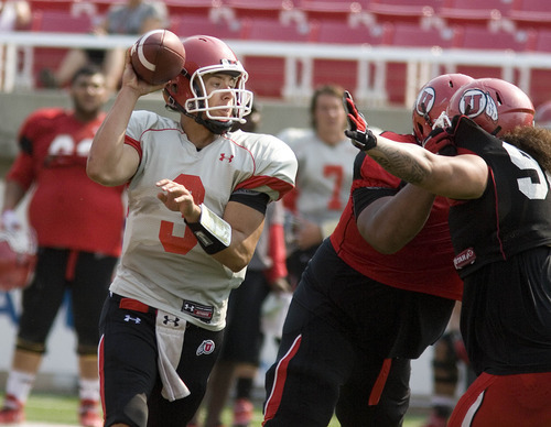 Paul Fraughton | The Salt Lake Tribune Utah quarterback Jordan Wynn practices Tuesday, Aug. 14, 2012.