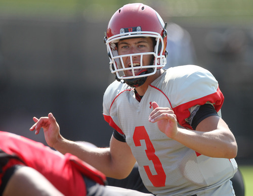 Lennie Mahler     The Salt Lake Tribune Utah quarterback Jordan Wynn calls a play during a practice scrimmage Saturday, Aug. 11, 2012.