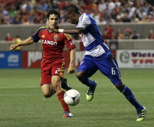 Rick Egan  | The Salt Lake Tribune   Real Salt Lake defender Tony Beltran (2) defends as Jackson (6) takes the ball down field for FC Dallas,  in MLS soccer action Salt Lake vs FC Dallas, at Rio Tinto Stadium, Saturday, August 18, 2012.