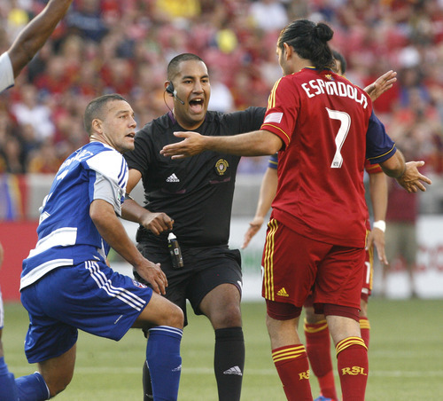 Rick Egan  | The Salt Lake Tribune   Real Salt Lake's Fabian Espindola (7) reacts after colliding with Daniel Hernandez (2) F.C. Dallas, in MLS soccer action, at Rio Tinto Stadium, Saturday, August 18, 2012.