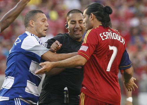 Rick Egan  | The Salt Lake Tribune   Real Salt Lake's Fabian Espindola (7) gets a shove from Daniel Hernandez (2) F.C. Dallas, in MLS soccer action, at Rio Tinto Stadium, Saturday, August 18, 2012.