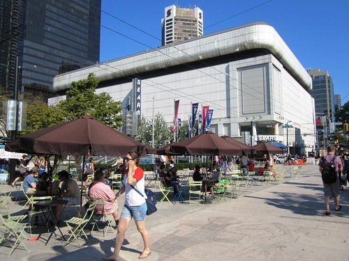 Courtesy Salt Lake City Redevelopment Agency Movable tables, chairs and umbrellas on Robson Street in Vancouver help create a lively and inviting downtown. Salt Lake City officials recently visited the city on the British Columbia coast to gain insight into urban vitality.