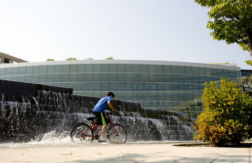 Kim Raff   The Salt Lake Tribune A boy rides his bike through the fountain at Library Square in Salt Lake City. City officials recently visited Vancouver on the British Columbia coast to gain insight into urban vitality.