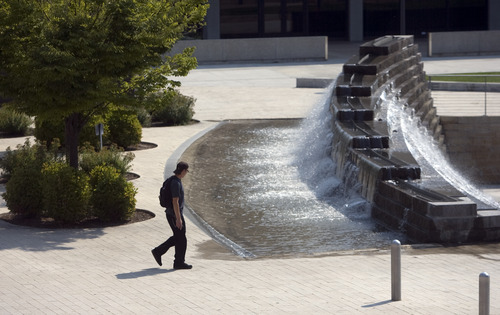Kim Raff     The Salt Lake Tribune A man walks by the fountain in Library Square in Salt Lake City. City officials recently visited Vancouver on the British Columbia coast to gain insight into urban vitality.