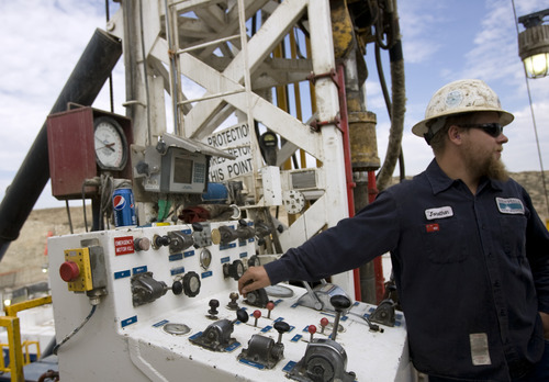 Kim Raff | The Salt Lake Tribune Jonathan Varelman mans the controls on a super single oil rig's drilling platform  in the Newfield Exploration Company's oil fields in Monument Butte near Roosevelt, Utah on August 9, 2012.
