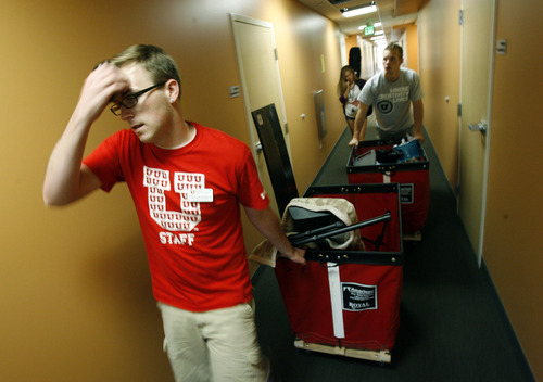 Francisco Kjolseth  |  The Salt Lake Tribune Resident advisor Trevor Myrick, left, is joined by Nick Christensen as they help Kristin Rector move into an eight-person unit of the new Donna Garff Marriott Residential Scholars Hall at the University of Utah on Thursday, Aug. 16, 2012.