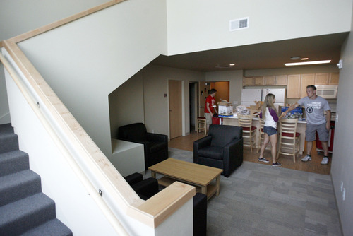 Francisco Kjolseth  |  The Salt Lake Tribune Nick Christensen, right, welcomes Kristin Rector during moving day at the University of Utah's new Donna Garff Marriott Residential Scholars Hall.