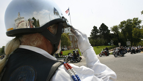 Scott Sommerdorf  |  The Salt Lake Tribune              Bruce Clements salutes Ride for the Fallen riders as they arrive at the Capitol for a ceremony featuring a special tribute to fallen officers Jared Francom and Aaron Beesley, Sunday, August 19, 2012.