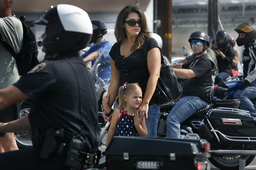 Scott Sommerdorf  |  The Salt Lake Tribune              Ogden police Officer Jared Francom' widow, Erin Francom, and 4-year-old daughter Hailey watch some of the riders leave Lindon to begin the ride to the state Capitol to honor her husband and Utah Highway Patrol Trooper Aaron Beesley, Sunday, August 19, 2012.