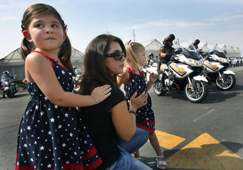 Scott Sommerdorf  |  The Salt Lake Tribune              Ogden police Officer Jared Francom's widow, Erin, and daughters, Samantha, 6, and Erin, 4, watch as officers turn out to begin the ride from Lindon to the state Capitol to honor fallen officers Francom and Trooper Aaron Beesley, Sunday, August 19, 2012.