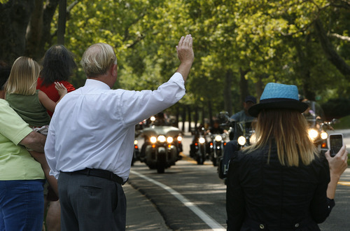 Scott Sommerdorf  |  The Salt Lake Tribune              People wave at some of the thousands of riders arriving at the state Capitol for a ceremony honoring fallen officers Agent Jared Francom and Trooper Aaron Beesley, Sunday, August 19, 2012.