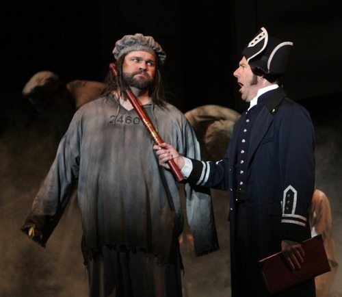 Rick Egan  | The Salt Lake Tribune   J. Michael Bailey (left), plays Jean ValJean and Brian Vaughn plays Inspector Javert, in the Utah Shakespeare Festival production of